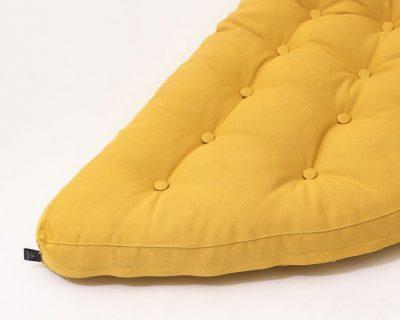 Cottoned crescent shape tufted cushion - edge detail